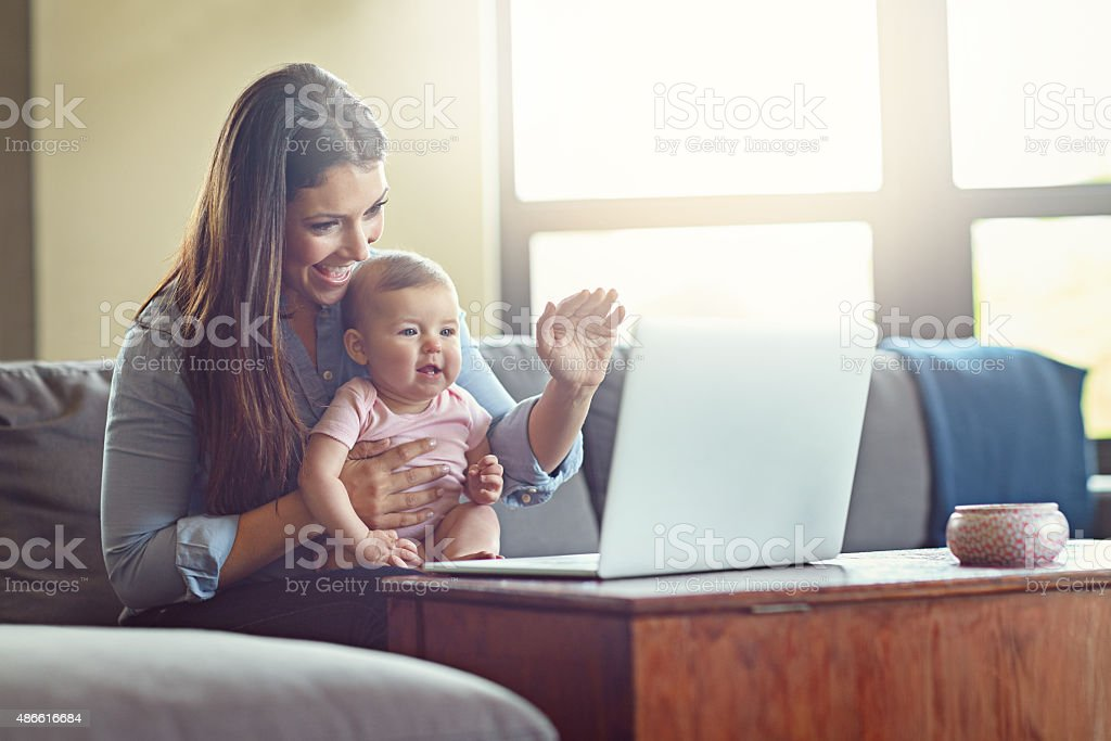 Say 'hi' to daddy! stock photo