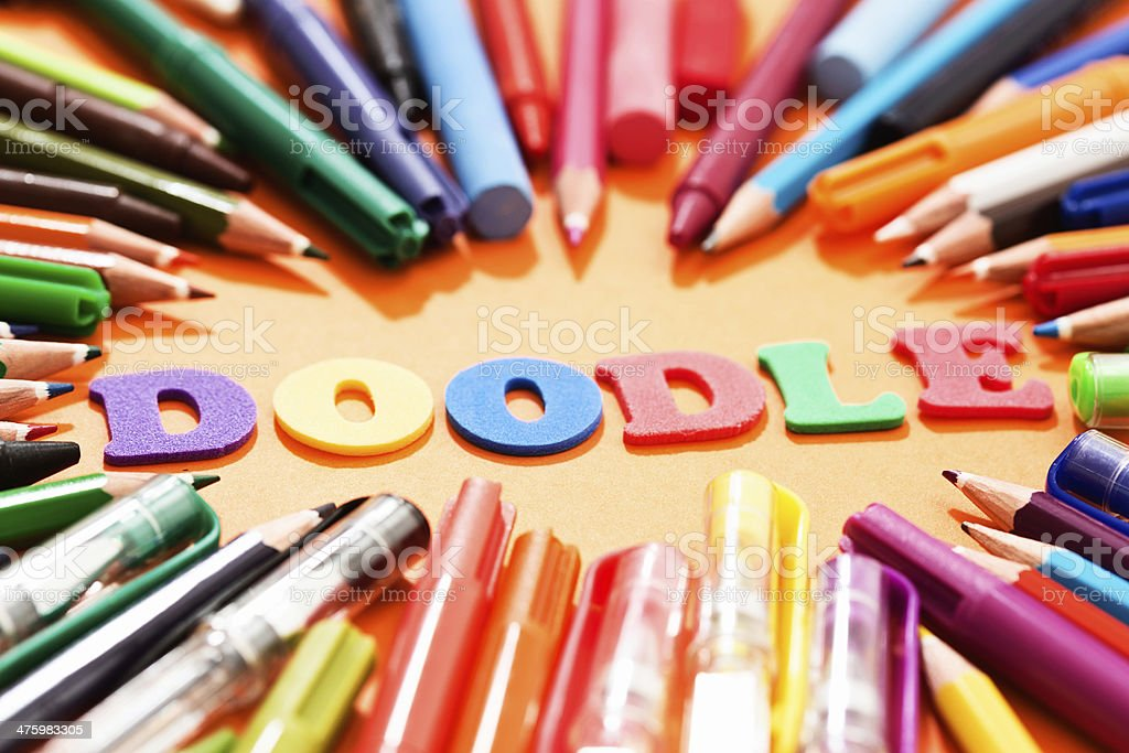 DOODLE say play letters surrounded by drawing materials: creative fun! royalty-free stock photo