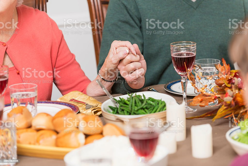 Saying grace before a meal stock photo