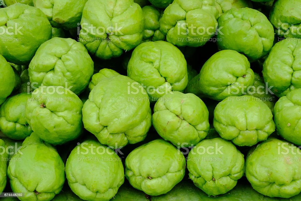 Sayote arranged on the table in market of Thailand's northern mountains. stock photo