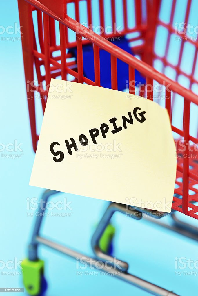 SHOPPING says label on tiny trolley, chore or fun? royalty-free stock photo