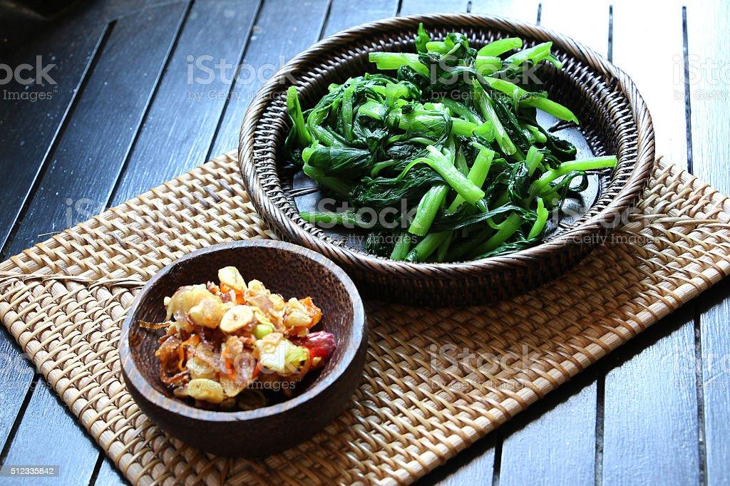 Sayur Gondo served with Sambal Matah stock photo