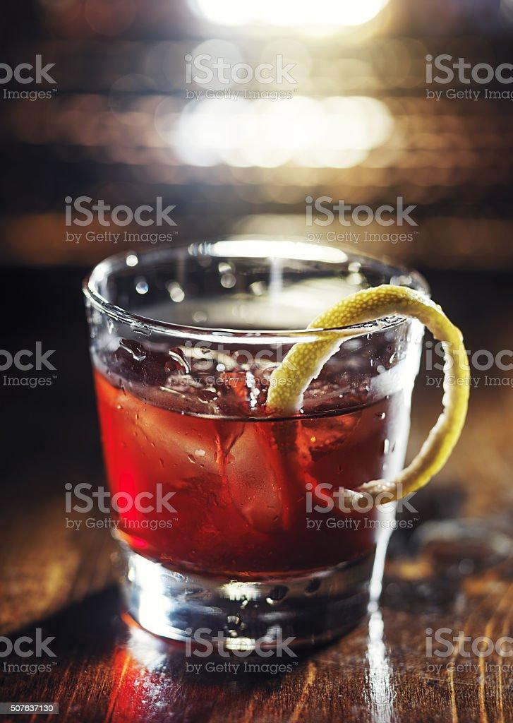 sazerac cocktail on wooden table stock photo
