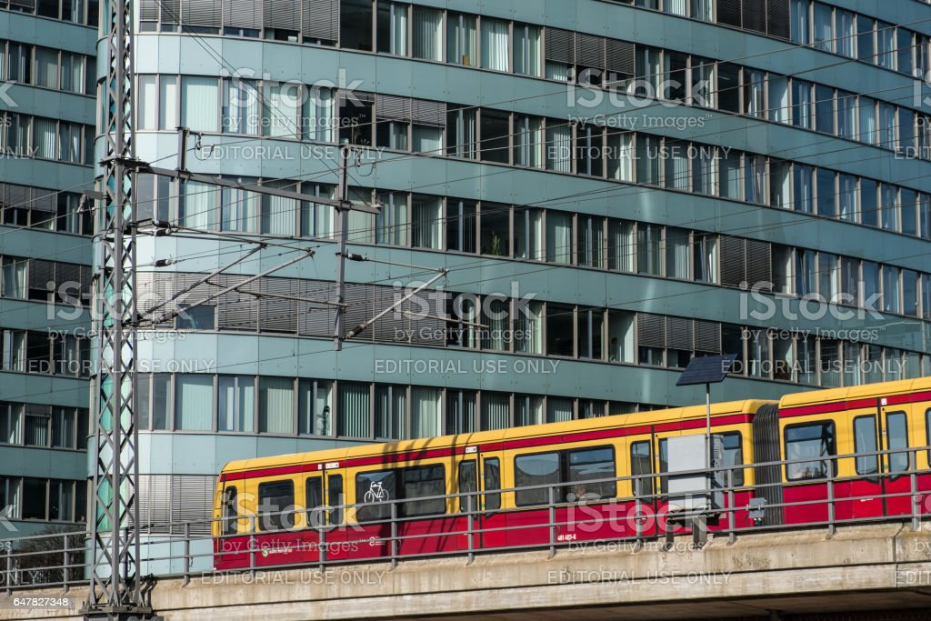 S-Bahn train in front of BVG office building stock photo