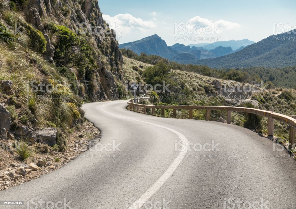 S-Bend on a winding mountain highway stock photo