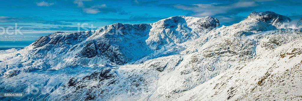 Scafell Pike winter snow Lake District mountain peaks panorama Cumbria stock photo