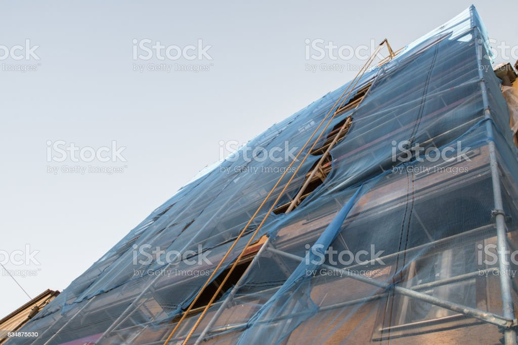 Scaffold on a old house for renovation stock photo