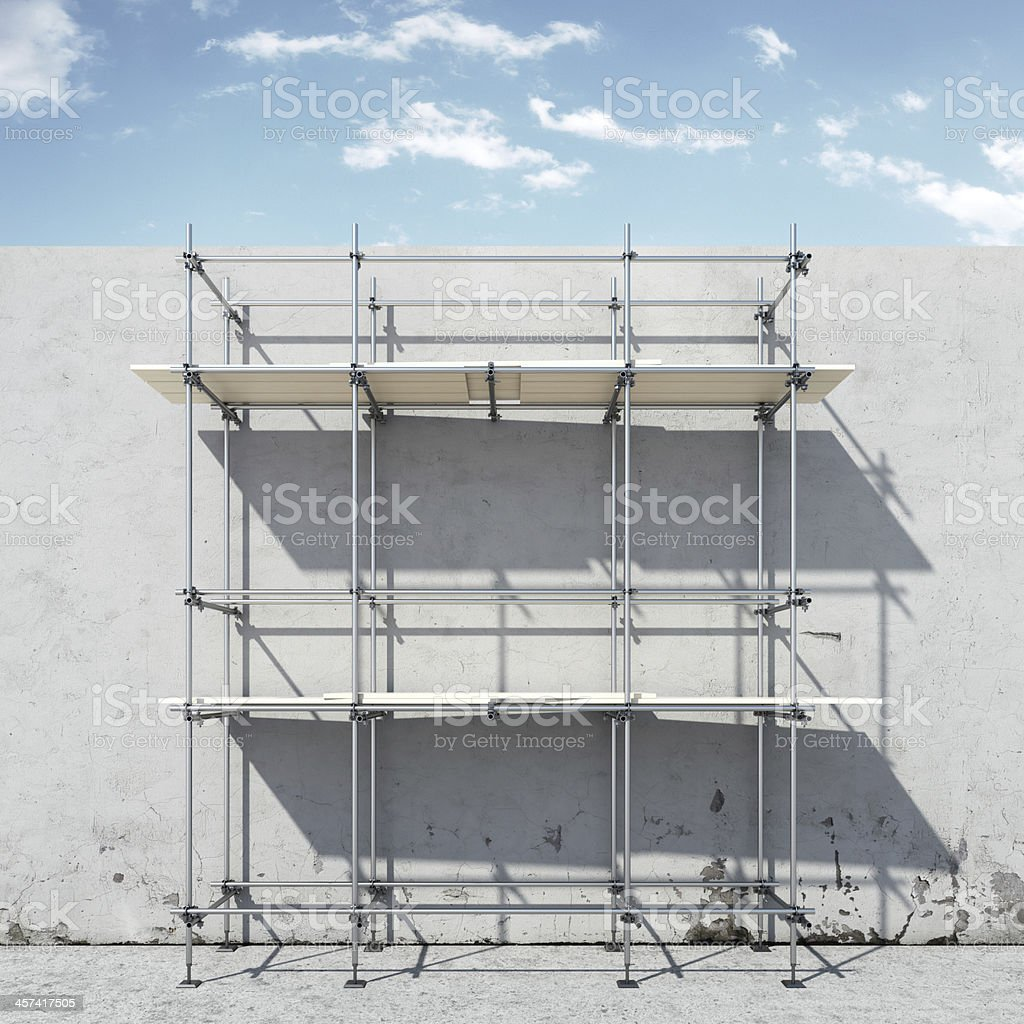 scaffold on wall in front of sky stock photo