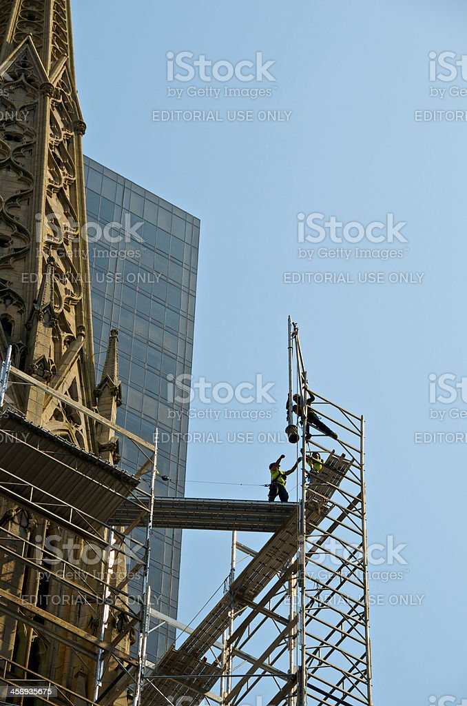 Scaffold workers on top of St. Patrick's Cathedral, Manhattan, NYC stock photo