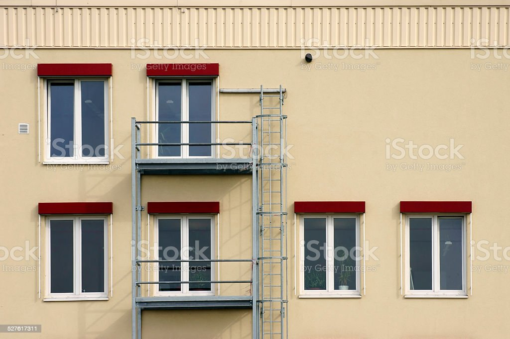 Scaffolding and fire ladder stock photo