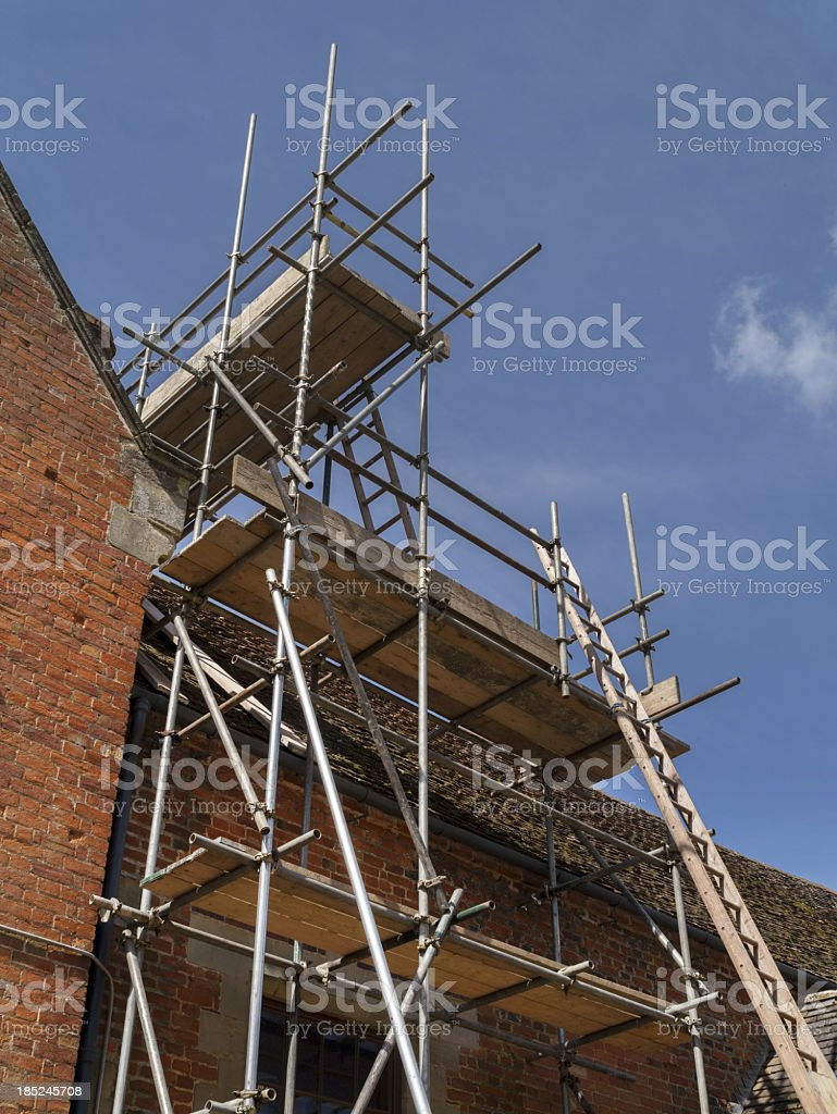 Scaffolding and rigging under a blue sky stock photo