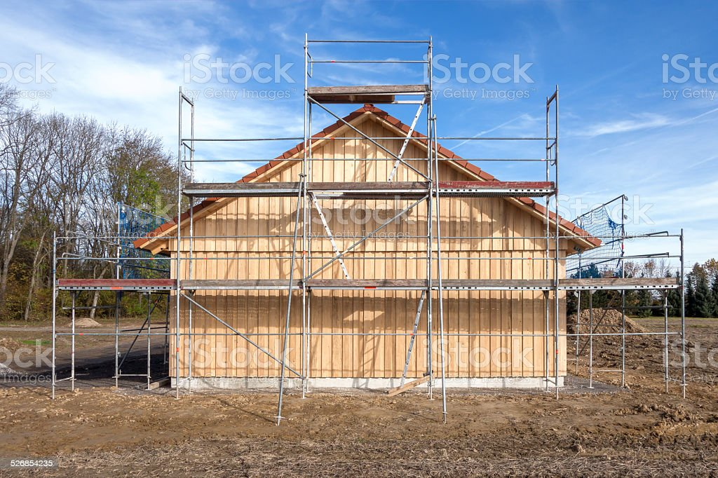 Scaffolding at a new wooden house royalty-free stock photo