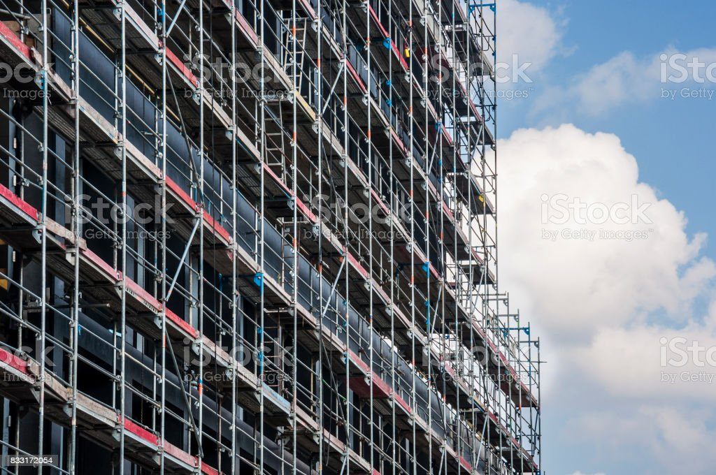 scaffolding at construction site of a glass office building stock photo
