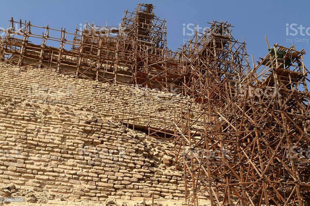 Scaffolding at the Step Pyramid of Saqqara in Egypt stock photo