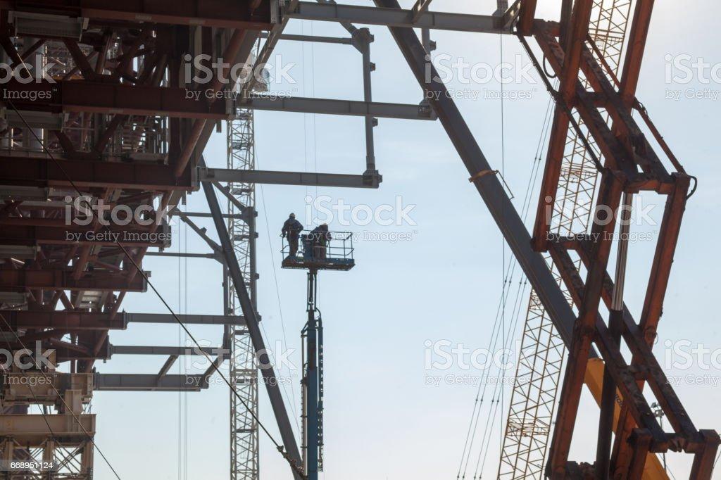 Scaffolding, cranes and elevating work platform stock photo