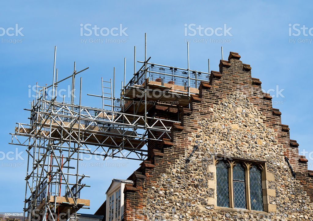 Scaffolding for renovations to an old building stock photo