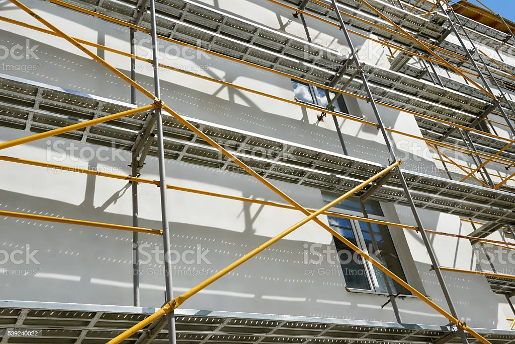 scaffolding near a house under construction for external plaster works stock photo