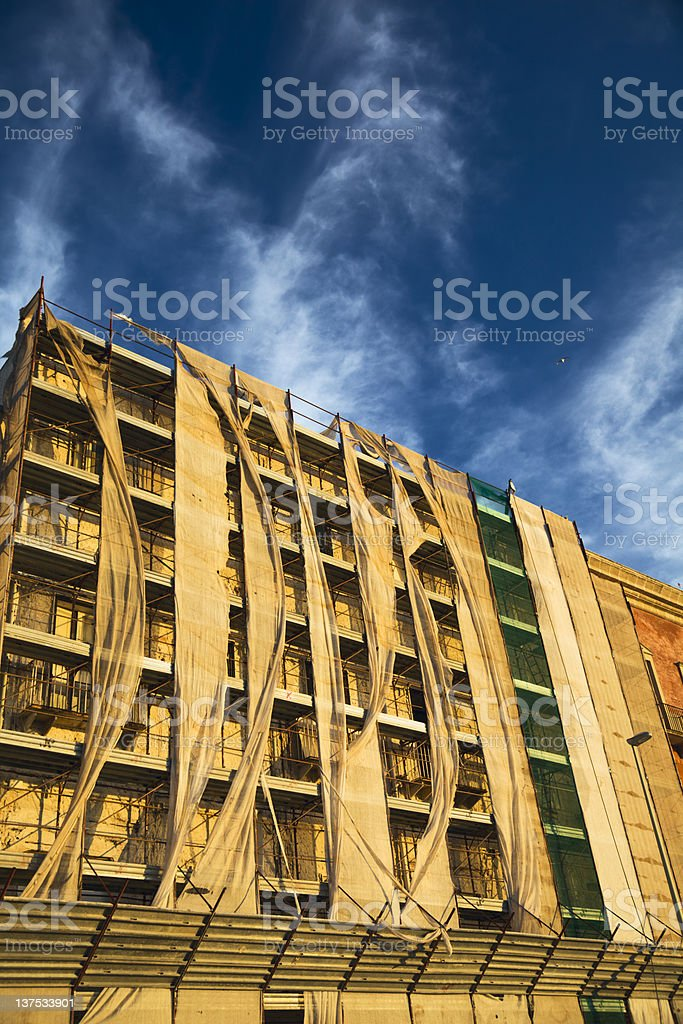 Scaffolding on the wind stock photo