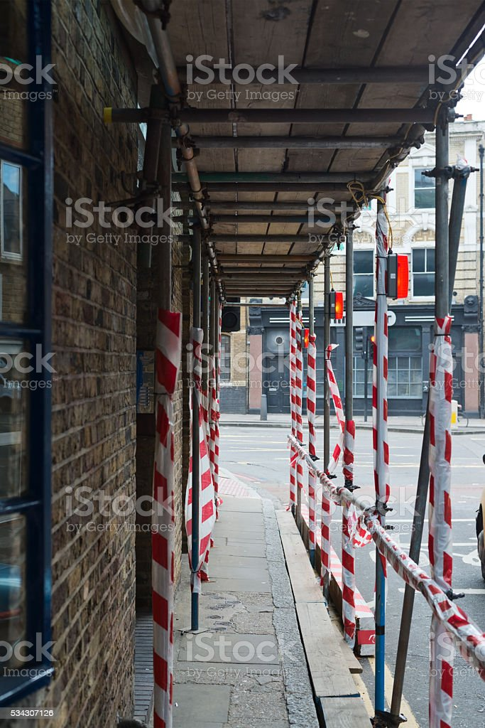 Scaffolding over the pedestrian footpath stock photo