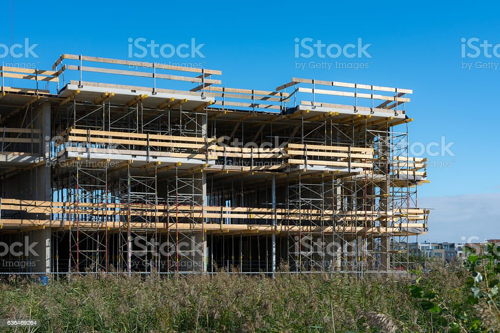 scaffolding with wooden floor reaching up in the sky stock photo