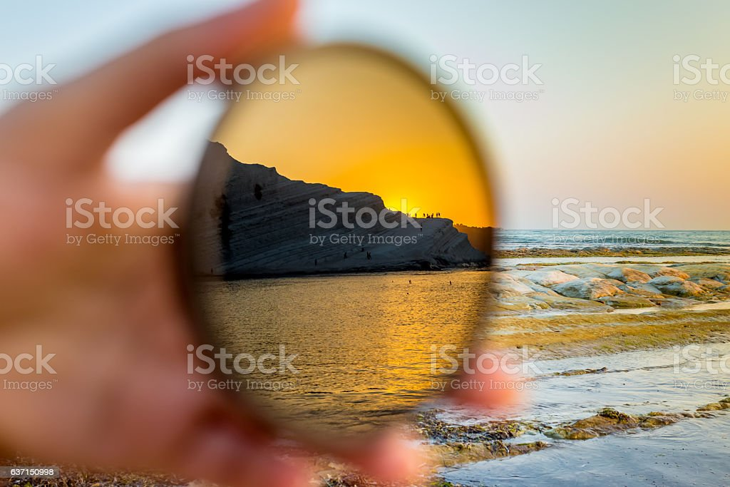 Scala dei Turchi reflected on a filter for the camera. stock photo