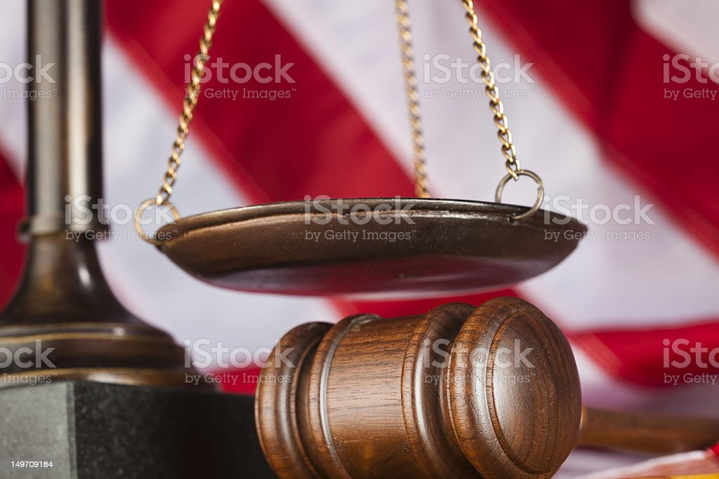 Scale and gavel against US flag royalty-free stock photo