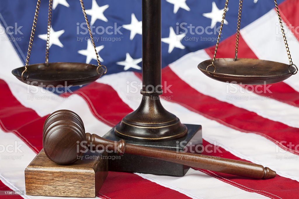 Scale and gavel on US flag royalty-free stock photo
