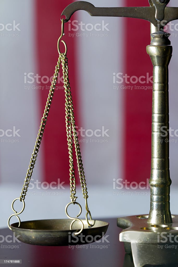 scale close with flag royalty-free stock photo
