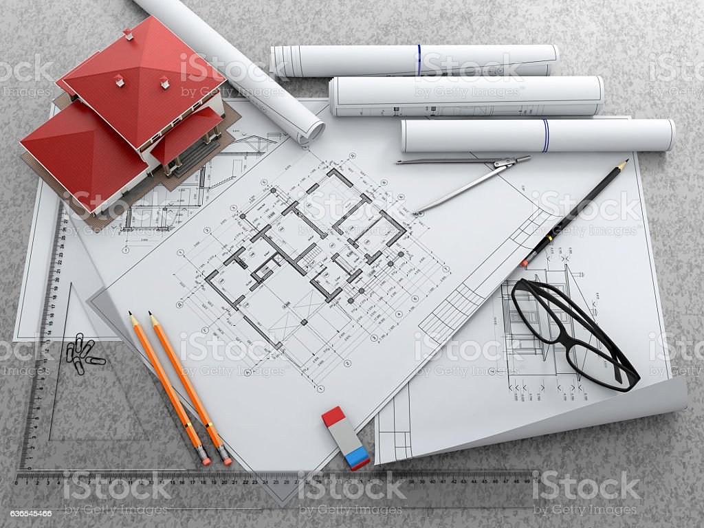 Scale model of house and architectural blueprints. stock photo