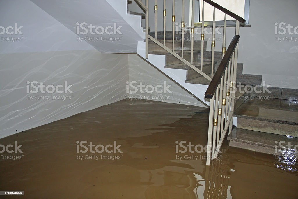 scale of a House fully flooded during the flooding stock photo