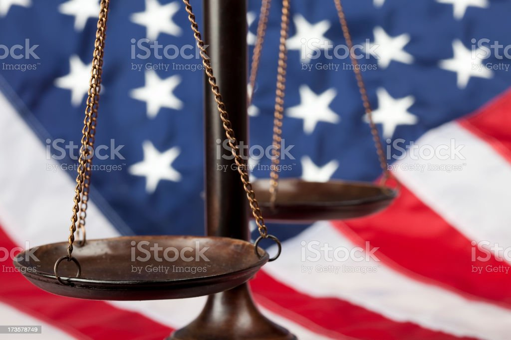 Scale of justice against US flag royalty-free stock photo