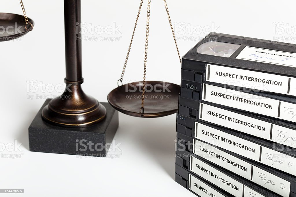 Scale of justice and interrogation tapes royalty-free stock photo