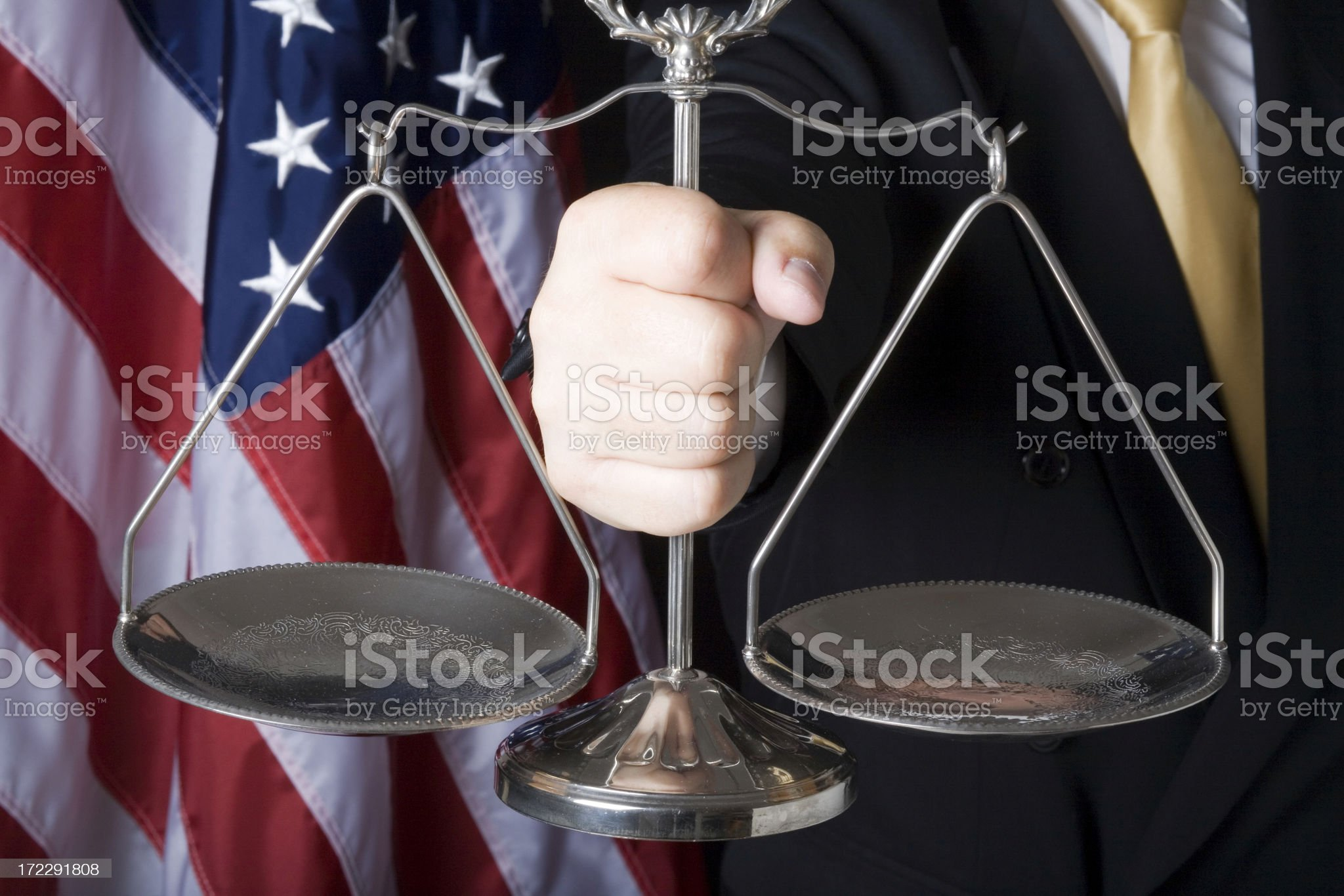 Scale of justice held in hand royalty-free stock photo
