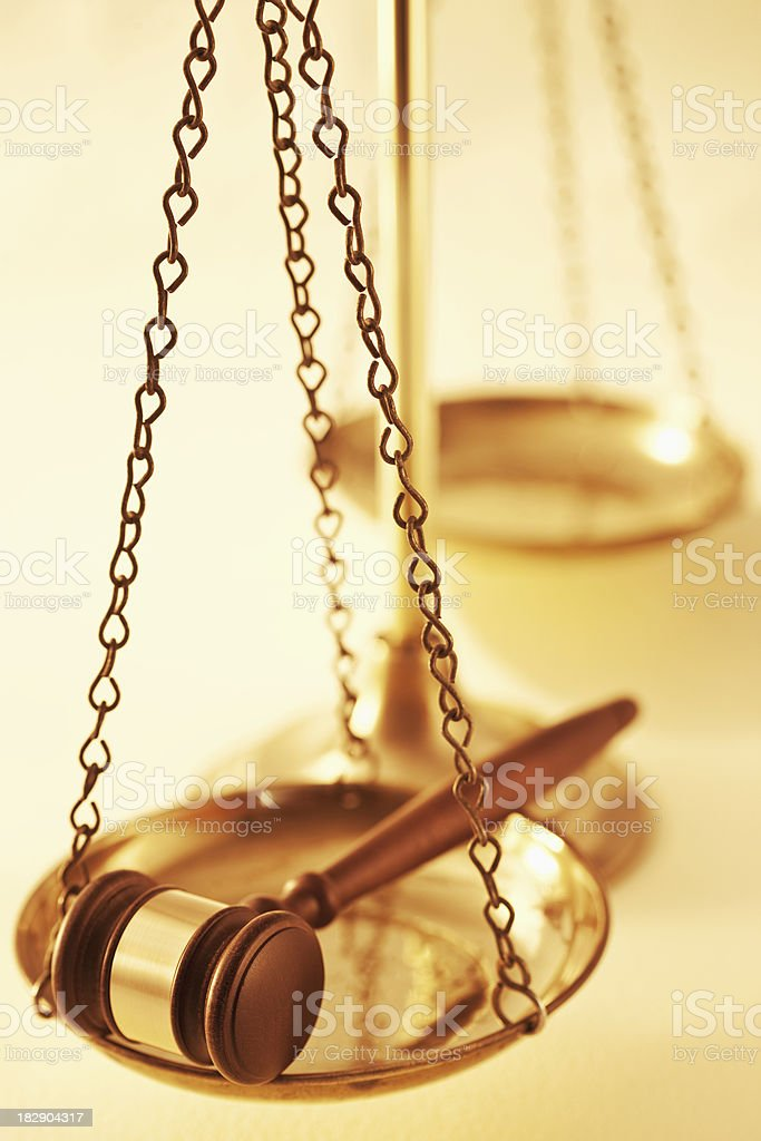 Scale of Justice Holding a Gavel royalty-free stock photo