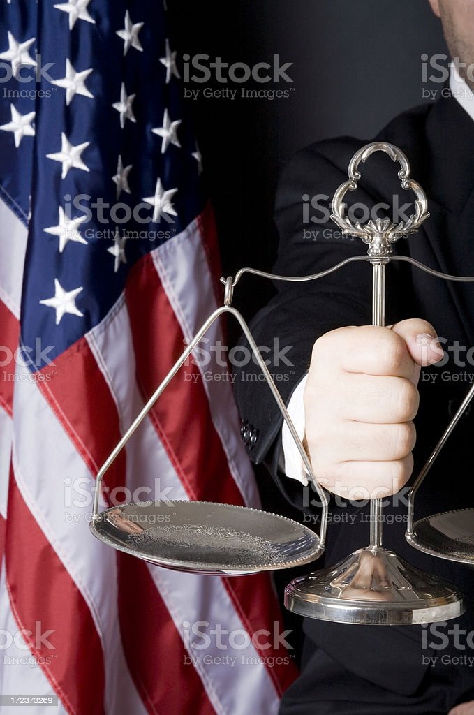 Scale of justice in judge's hand royalty-free stock photo