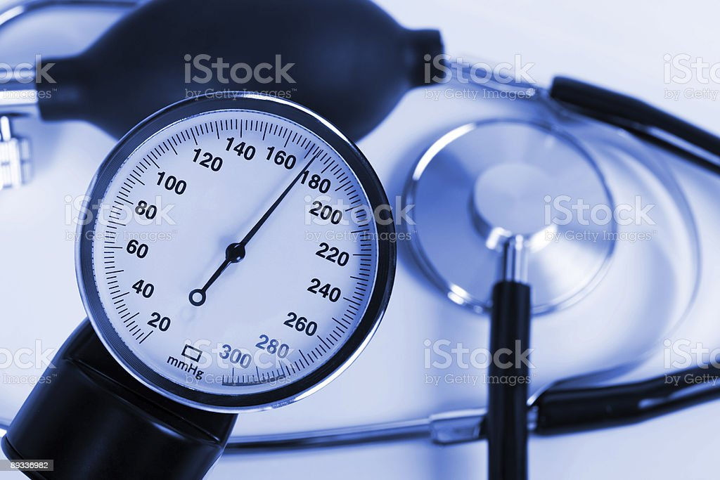 Scale of pressure and stethoscope royalty-free stock photo