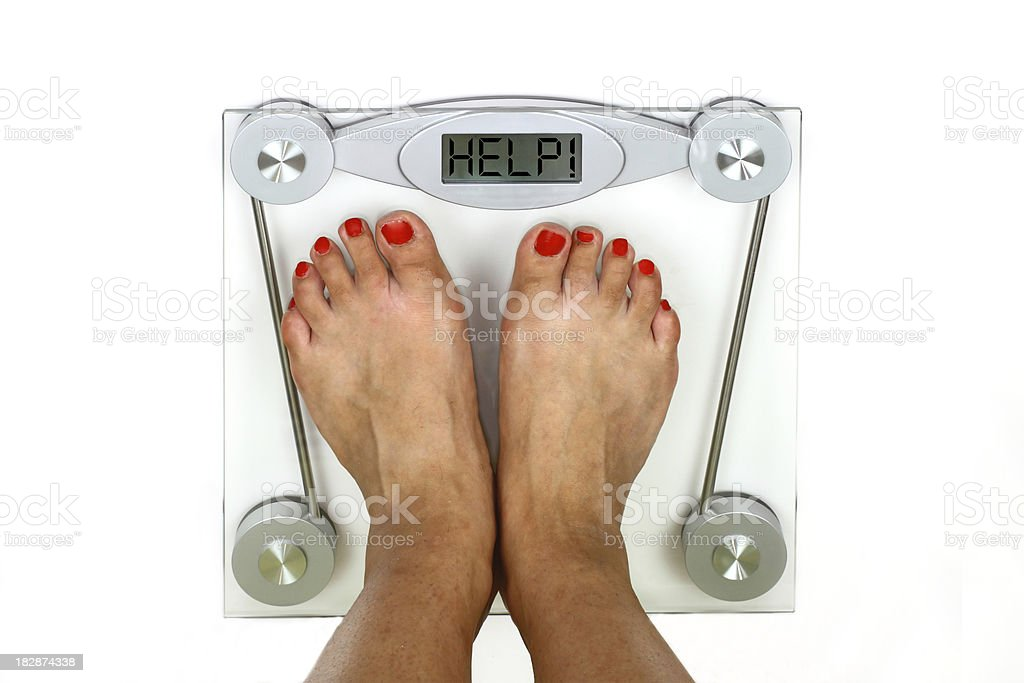 Scale overweight royalty-free stock photo