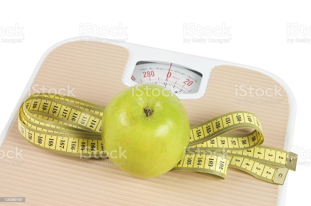 Scale, tape and apple on white background royalty-free stock photo