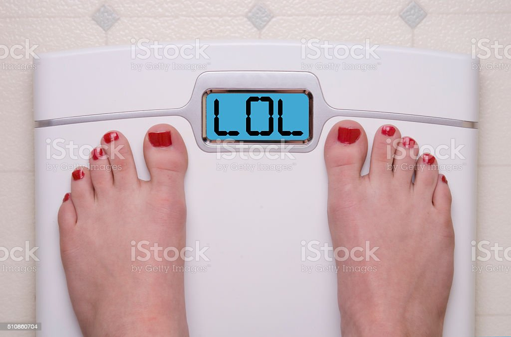 Scale with Feet LOL stock photo