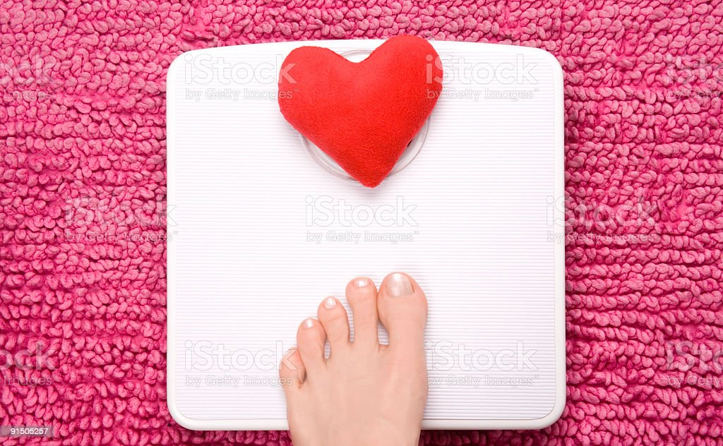 Scales heart step stock photo