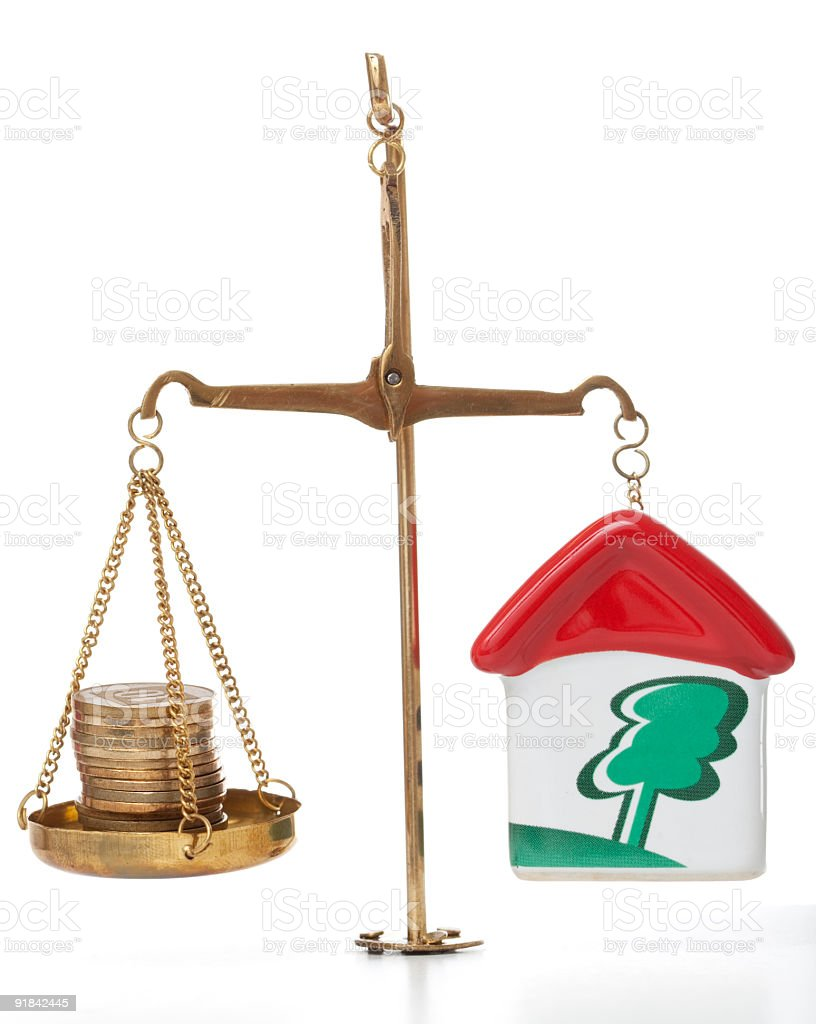 Scales money vs. real property stock photo