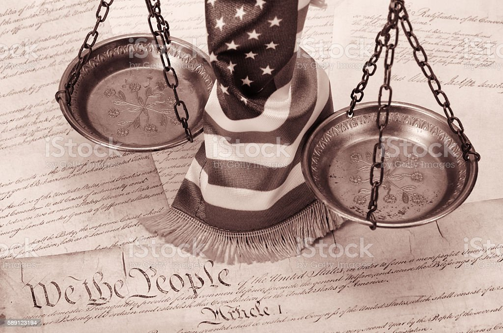 Scales of justice , American flag and US Constitution stock photo