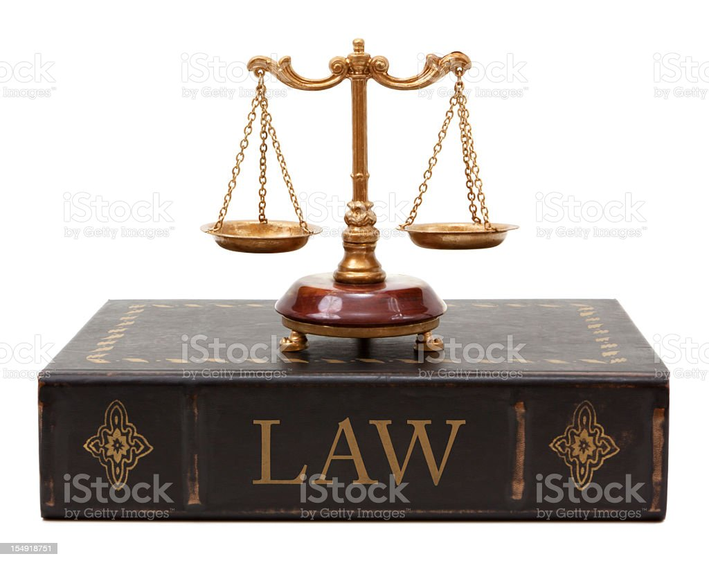 Scales of justice and law book royalty-free stock photo