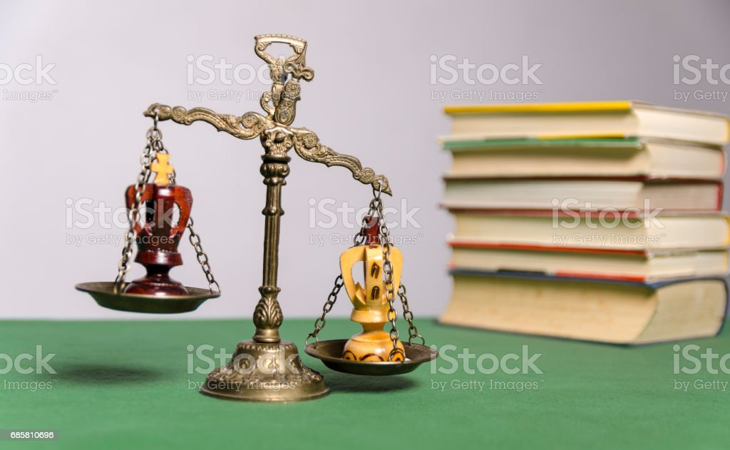 Scales of justice concept, chess kings on scales stock photo