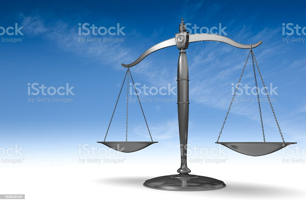 Scales of justice in front of a blue sky background royalty-free stock photo