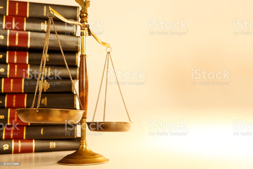 Scales Of Justice In Front Of Stack  Of Law Books stock photo