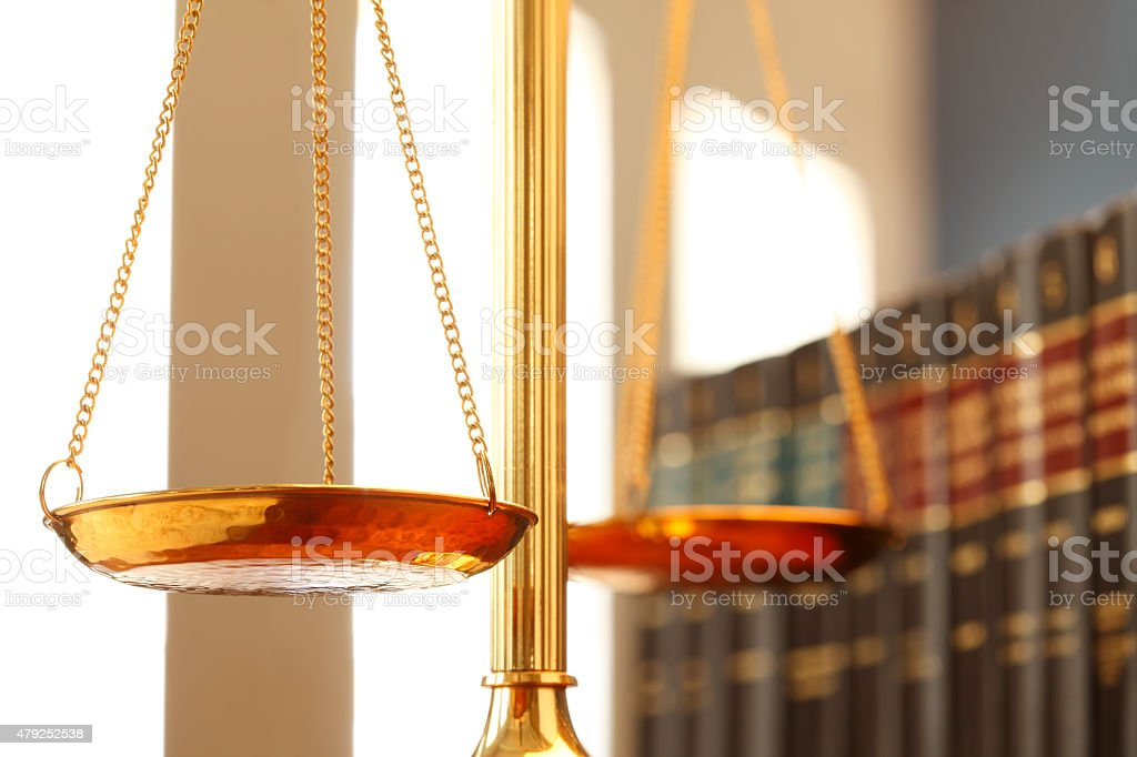 Scales Of Justice On Desk In Law Office With Law Books stock photo