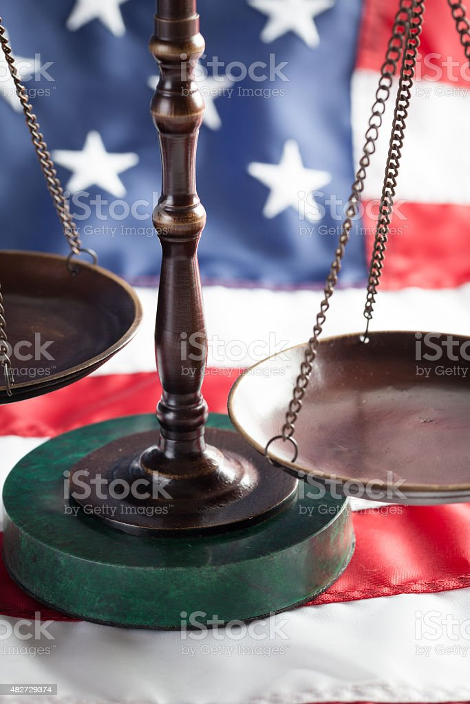 Scales of Justice on Flag stock photo