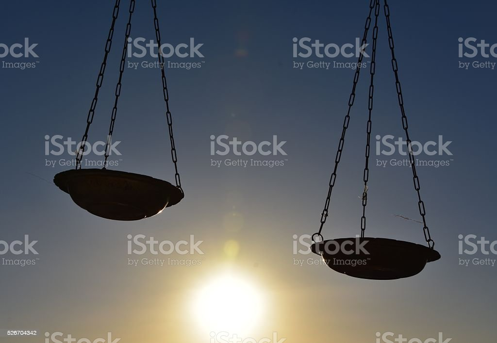 Scales of justice silhouette stock photo