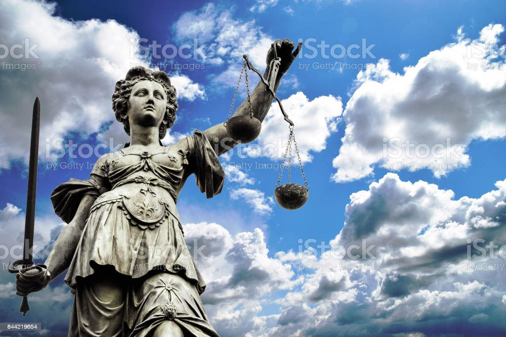 Scales of justice symbol stock photo